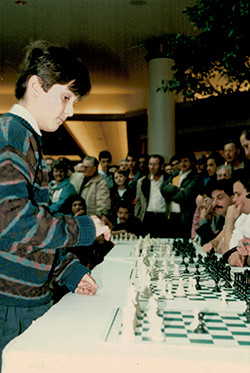 Lev Becker plays chess as a child