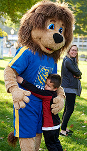 RBC lion hugging kid